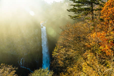 beautiful autumn landscape of waterfall and sun beams, Kegon, Nikko, Japan, nature background