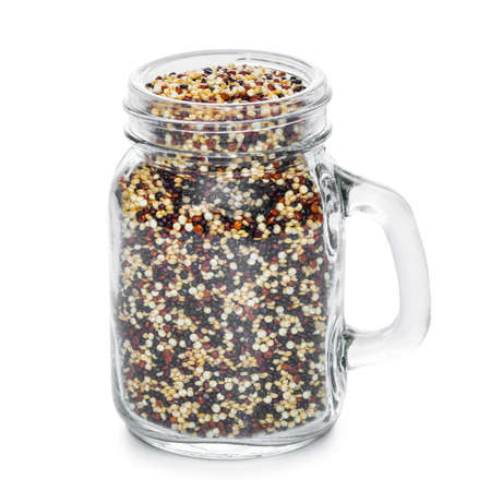 Quinoa seeds in jar isolated on white