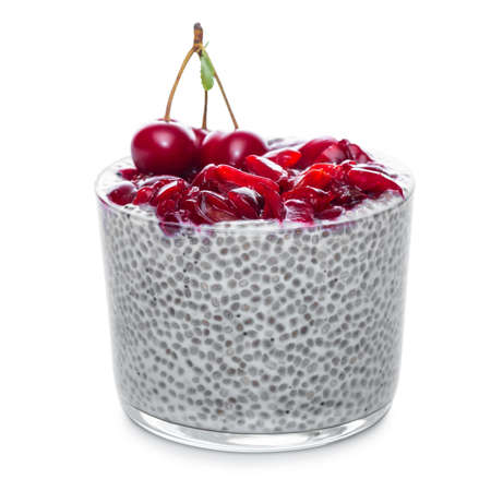 Chia seeds pudding with cherries in glass isolated on white Stock Photo