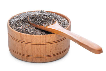 Dry chia seeds in natural wooden pot with spoon isolated on white Stock Photo