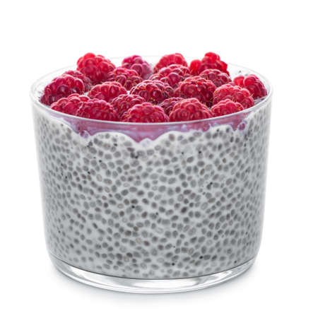 Chia seeds pudding with raspberries in glass isolated on white