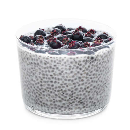 Chia seeds pudding with saskatoon berries in glass isolated on white