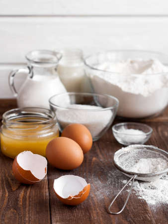 baking ingredients: Ingredients for the pancake on the wooden table