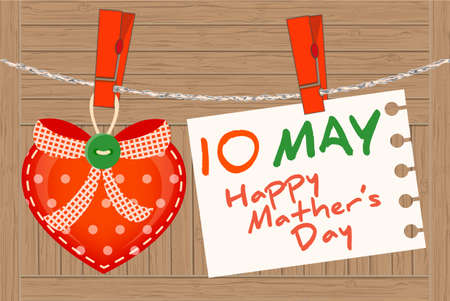 may: May 10th Mothers Day. Heart greeting and note on a clothesline with clothespins