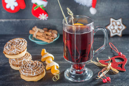 Mulled wine, cookies and tangerin. Christmas background.