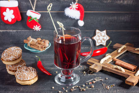 convivial: Mulled wine and cookies on the Christmas decorated background. Hot and tasty. Stock Photo