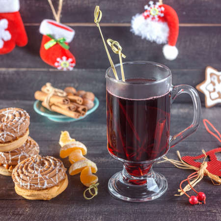 convivial: Mulled wine, cookies and tangerines and cinnamon. Christmas background.
