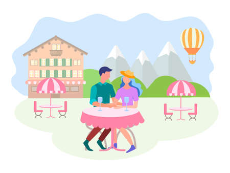 Young people in love at a table street cafe in a mountain resort. Concept happy couple on a date and during the honeymoon.