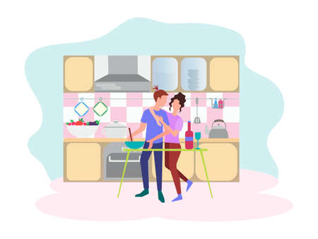Young people hug and cook dinner in the kitchen. The concept of a date in the kitchen.