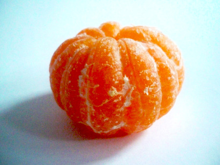 ripe peeled tangerine on white background Imagens