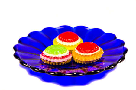 cookies in blue glass plate isolated on white photo