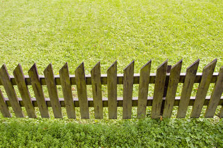 wooden fence and green grass yard Stock Photo - 11225145