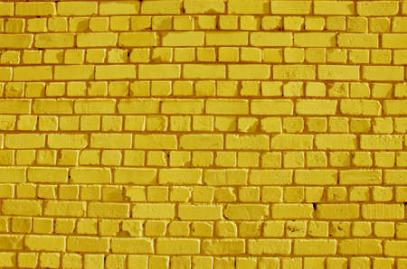 painted bricks yellow wall background and texture