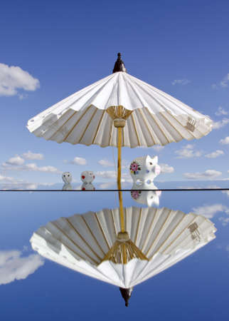 thrift box: piggybanks on mirror and white umbrella