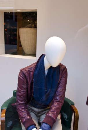 modern manikin in the city shop showcase photo