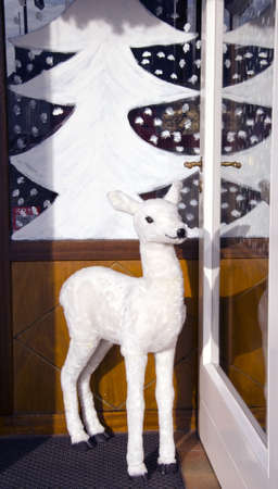white  Christmas hind in the cafe door photo