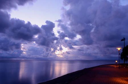 early sunrise in the sea bay and clouds