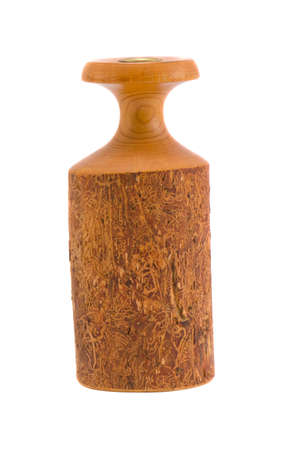 isolated on white turned wooden candlestick photo