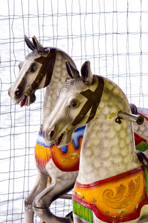 two colorful carousel horses in winter time photo