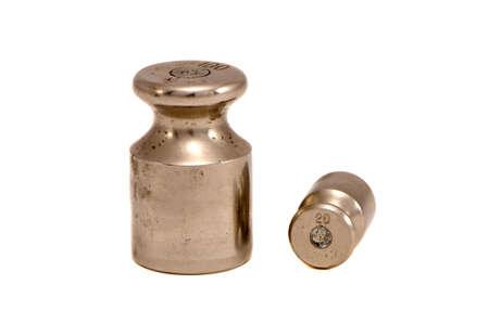 calibration: isolato su bianco due pesi di calibrazione metallici