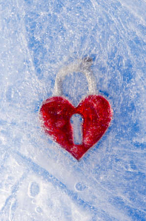 love symbol red heart frozen in winter ice photo