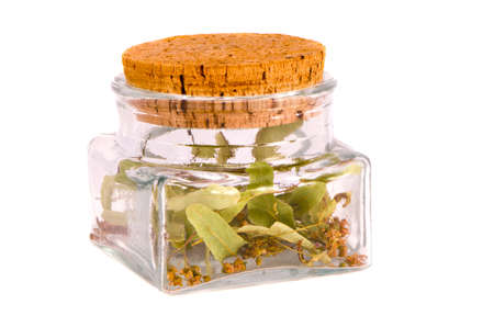 isolated on white glass jar with linden  blossoms herbal tea