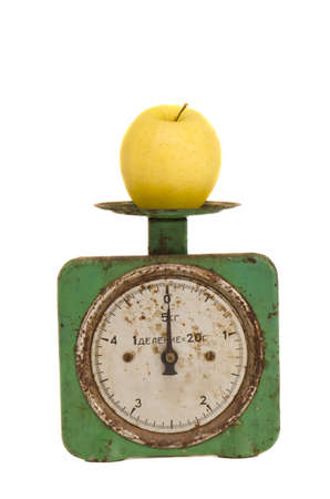 isolated vintage and grunge scale with one yellow apple Stock Photo - 12442333