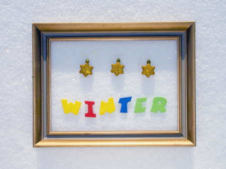 colorful word winter in the frame on pure snow Stock Photo - 12442319