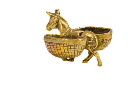 isolated on white brass burro with baskets souvenir photo