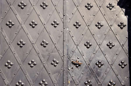 historical metal doors black background and texture photo