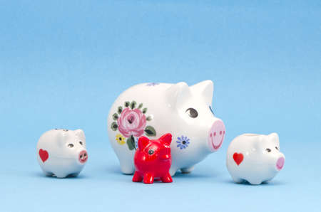 vaus four piggy-banks on azure background Stock Photo - 13024204