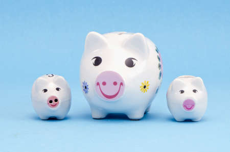 three funny piggybanks on azure background Stock Photo - 13089601