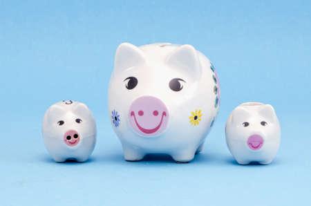 three funny piggybanks on azure background Stock Photo - 13089601
