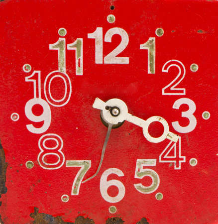 red and old broken clock face photo