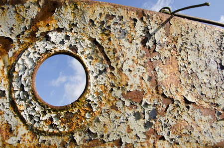 old and rusted metal ship fragment