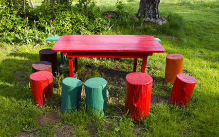 colorful rural garden furniture in springtime Stock Photo