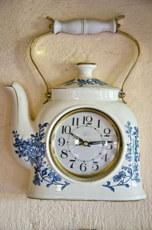 retro original teapot form design clock on wal photo