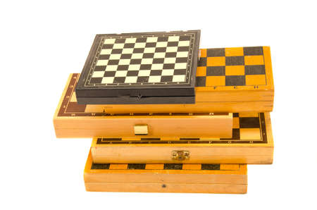 isolated on white vintage various chess boxes photo