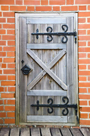 old gray wooden door in the castle Stock Photo - 14637929