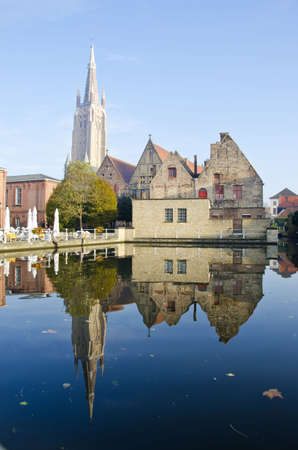 sulight: old town and church in Belgium Brugge
