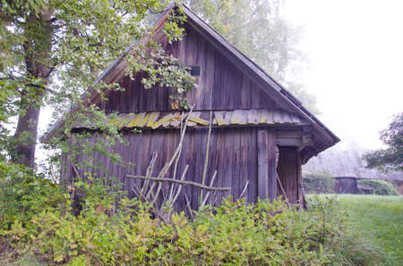 old broken wooden barn in farm photo