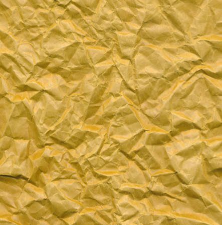 wrinkled paper yellow background photo
