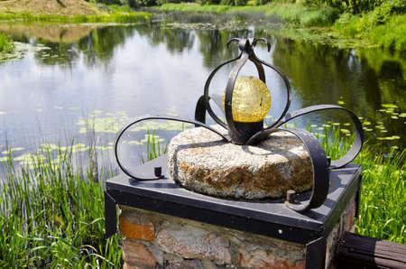 millstone: original lamp on millstone near tourism farm pond