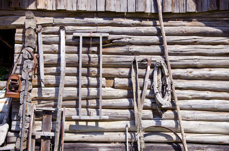 ancient wooden etnographic barn wall with farm tools Stock Photo - 15596527