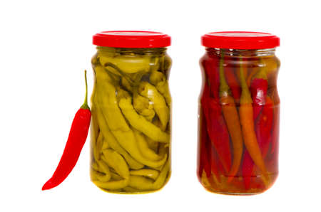 two isolated on white glass jars with red and green peppers photo