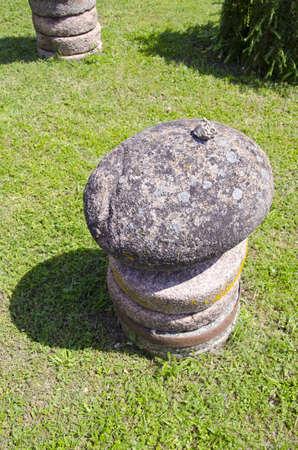 millstone: stone and millstone in farm on grass