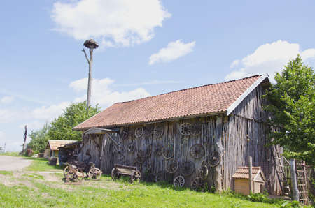old barn in farm with carriage wheel collection Stock Photo - 15630421
