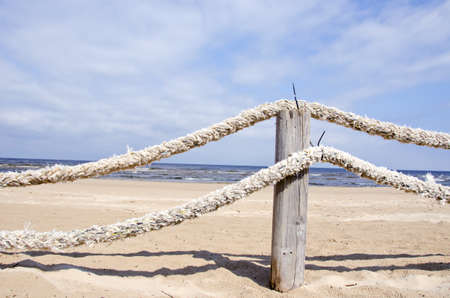 old ropes fence on resort beach nea sea