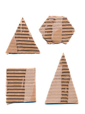 trigonal: various corrugated package paper forms isolated on white background