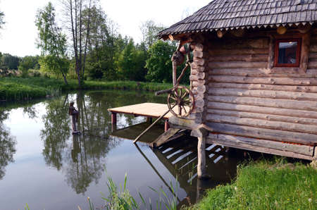 bathhouse: old wooden bathhouse and summer  pond Stock Photo